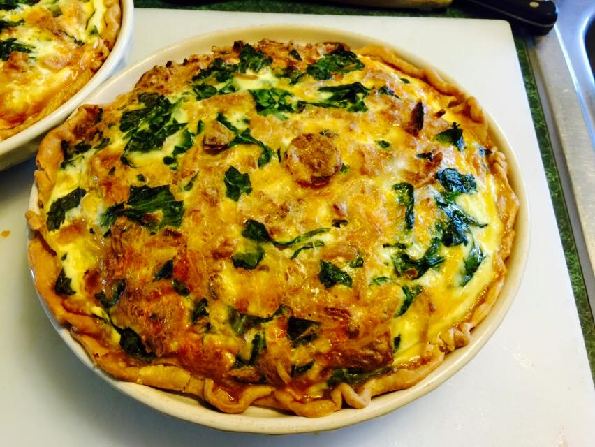 Freshly baked spinach and cheddar quiche