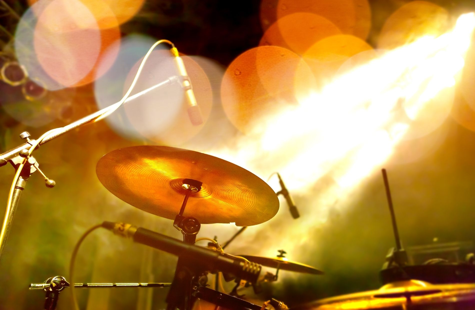 Drum set on a stage surrounded by lights