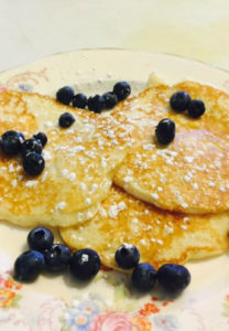 Three pancakes with blueberries on top