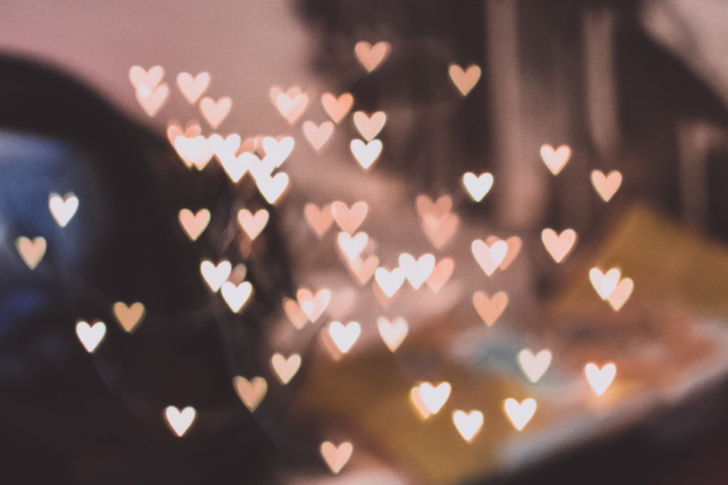 Pastel hearts over a blurry background.