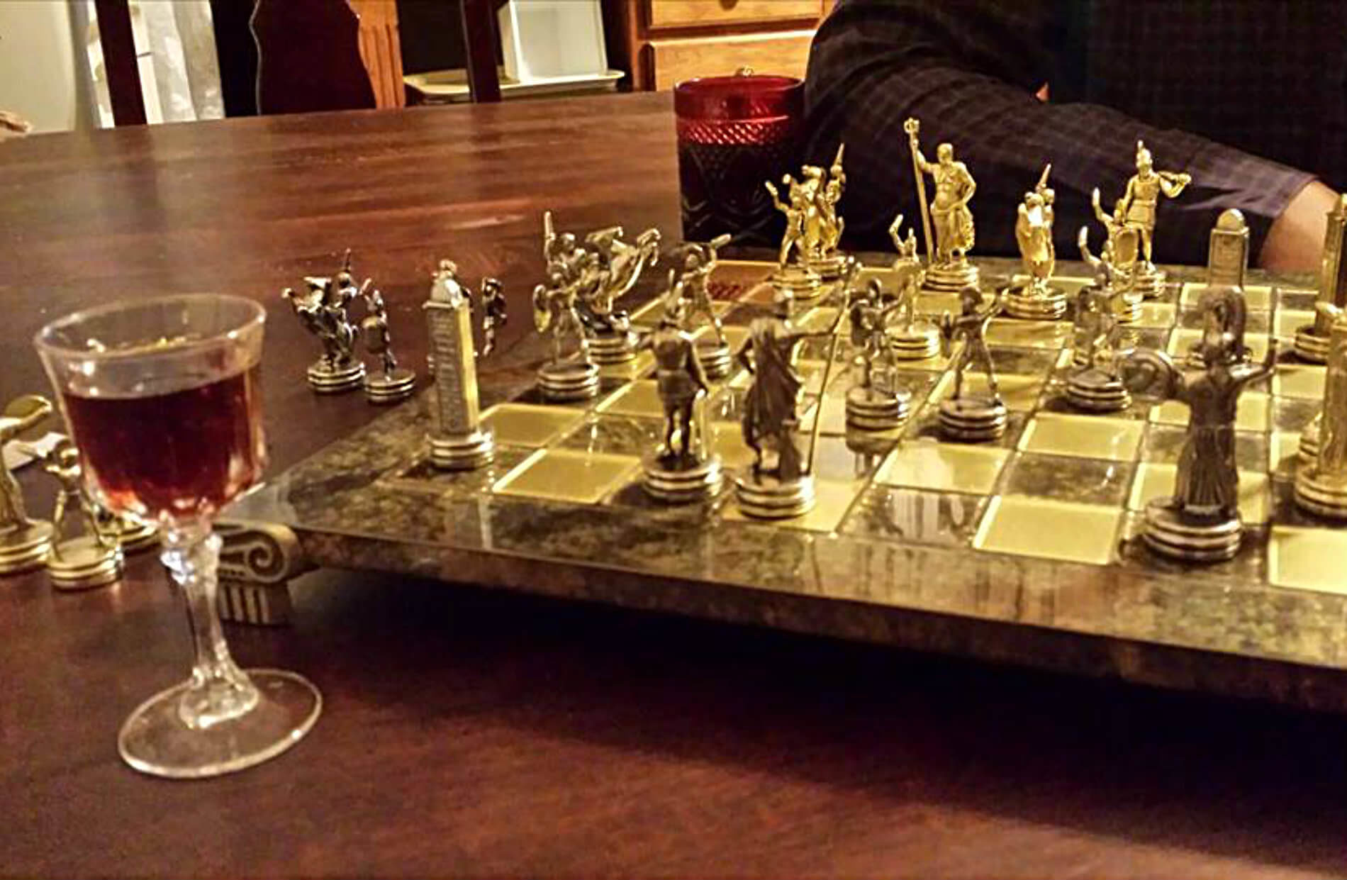 Beautiful chess board set with silver chess pieces on glossy wood table