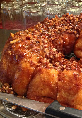 Golden brown caramel pecan pull-part bread covered with nuts