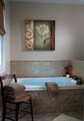 Serene bath with tile backsplash and large flower picture