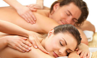 Woman and man having a couples massage