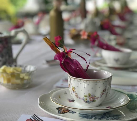 floral teacup on white tablecloth