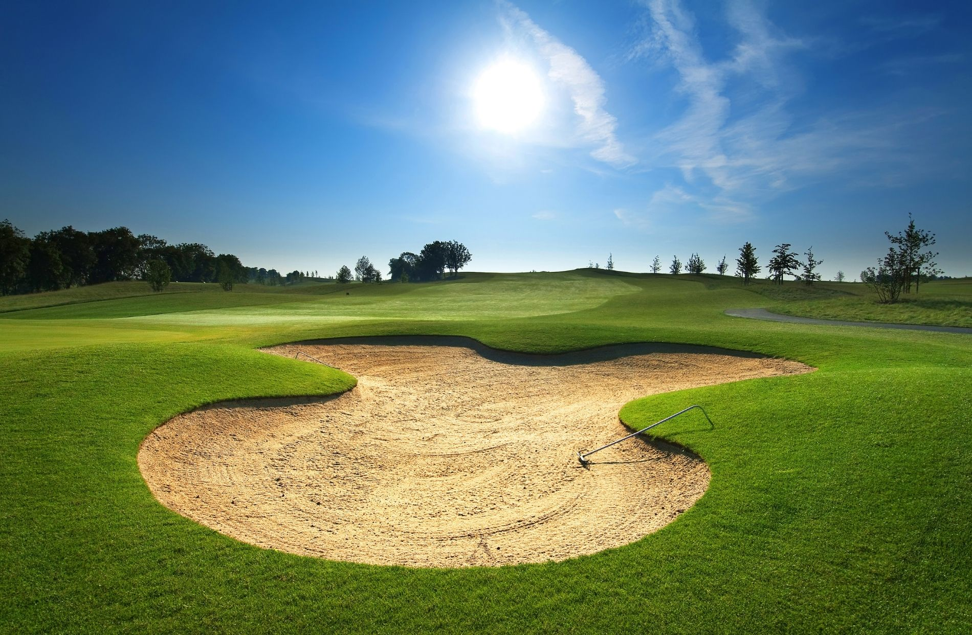 View of golf course, sand trap and blue skies